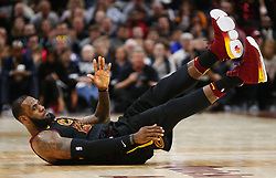 April 29, 2018 - Cleveland, OH, USA - Cleveland Cavaliers forward LeBron James slides down the floor after an aggressive play against Indiana Pacers forward Bojan Bogdanovic in the third quarter of Game 7 of the Eastern Conference First Round series on Sunday, April 29, 2018 at Quicken Loans Arena in Cleveland, Ohio. The Cavs won the game, 105-101. (Credit Image: © Leah Klafczynski/TNS via ZUMA Wire)