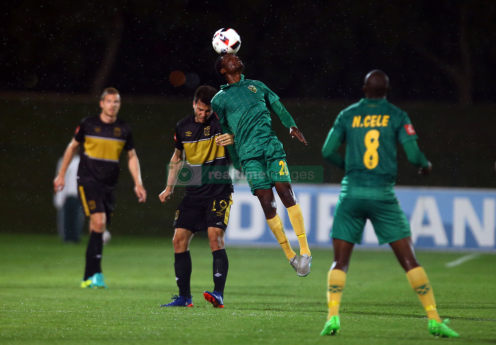 Danny Phiri of Golden Arrows heads the ball away from Roland Putsche of Cape Town City during the 2016 Premier Soccer League match between Golden Arrows and Cape Town City FC held at the Prince Magogo Stadium in Durban, South Africa on the 14th September 2016<br /> <br /> Photo by:   Steve Haag / Real Time Images