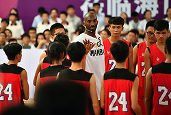 HAIKOU, Sept. 12  Former NBA basketball player Kobe Bryant (C) attends a basketball teaching activity with young basketball fans in Haikou, capital of south China's Hainan Province, Sept. 12, 2017. (Credit Image: © Guo Cheng/Xinhua via ZUMA Wire)