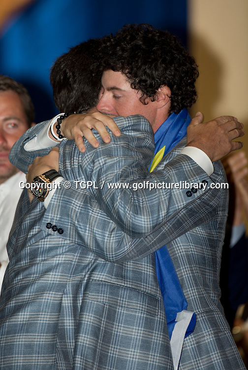 Jose Maria OLAZABAL (EUR) hugs Rory MCILROY (EUR) during final day Singles,Ryder Cup Matches,Medinah CC,<br /> Medinah,Illinois,USA.