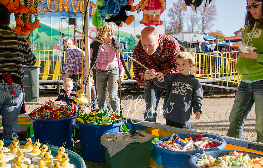 Michael and Alex Lewis at the rubber ducky fishing hole in the Midway at the Sandwich Fair on Monday.  (Karen Bobotas/for the Laconia Daily Sun)