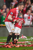 Football - Premier League 2012 / 2013 - Manchester United vs. Swansea<br /> Wayne Rooney of Manchester United with son Kai at Old Trafford