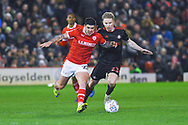 Alex Mowatt of Barnsley (27) and Grant Leadbitter of Sunderland (23) in action during the EFL Sky Bet League 1 match between Barnsley and Sunderland at Oakwell, Barnsley, England on 12 March 2019.
