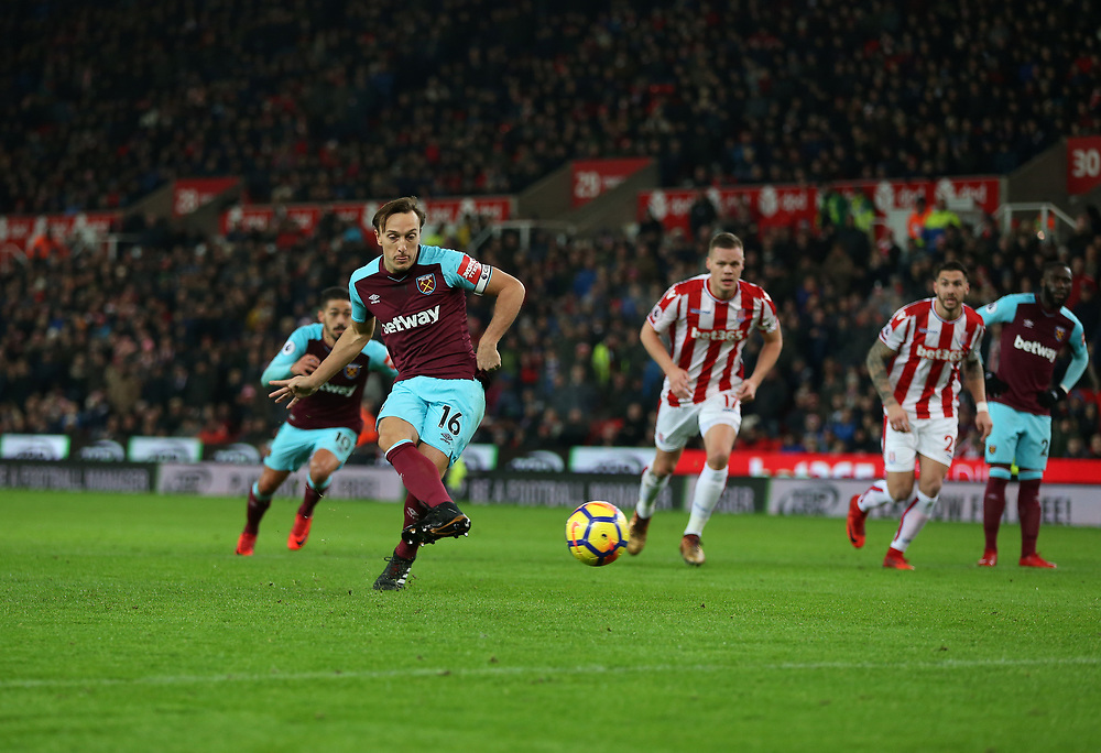 West Ham United's Mark Noble scores his side's first goal   from the penalty spot<br /> <br /> Photographer Rob Newell/CameraSport<br /> <br /> The Premier League - Stoke City v West Ham United - Saturday 16th December 2017 - Britannia Stadium - Stoke-on-Trent <br /> <br /> World Copyright © 2017 CameraSport. All rights reserved. 43 Linden Ave. Countesthorpe. Leicester. England. LE8 5PG - Tel: +44 (0) 116 277 4147 - admin@camerasport.com - www.camerasport.com