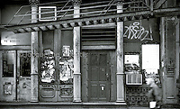 B&W Film Image of old building in SoHo New York City with graffiti by Jacqueline C Agentis.  Limited Edition 1 of 25