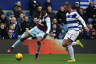 Jonathan Kodjia of Aston Villa goes past Joel Lynch of Queens Park Rangers (R). EFL Skybet championship match, Queens Park Rangers v Aston Villa at Loftus Road Stadium in London on Sunday 18th December 2016.<br /> pic by Steffan Bowen, Andrew Orchard sports photography.