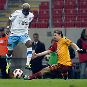 Galatasaray's Ayhan AKMAN (R) and Trabzonspor's Ibrahima YATTARA (L) during their Turkish superleague soccer derby match Galatasaray between Trabzonspor at the TT Arena in Istanbul Turkey on Sunday, 10 April 2011. Photo by TURKPIX