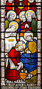 Stained glass window East Bergholt church, Suffolk, England, UK c 1881 by Clayton and Bell detail off Jesus washing feet, he loved them to the end