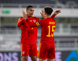 HELSINKI, FINLAND - Thursday, September 3, 2020: Wales' Ben Cabango (L) and Ethan Ampadu celebrate after the UEFA Nations League Group Stage League B Group 4 match between Finland and Wales at the Helsingin Olympiastadion. Wales'  won 1-0. (Pic by Jussi Eskola/Propaganda)