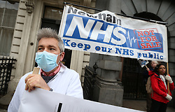 © Licensed to London News Pictures. 30/11/2015. London, UK.  National Health Service workers and other supporters protest against the National Health Service (NHS) being part of the Transatlantic Trade and Investment Partnership (TTIP) by carrying a giant version of their petition around Westminster. Photo credit: Peter Macdiarmid/LNP