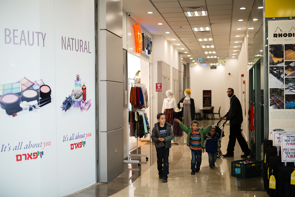 A Jewish family is seen in a recently opened shopping center located at the Gush Etzion junction, near the West Bank Jewish settlement of Efrat in the Gush Etzion settlement bloc, which is situated on the southern outskirts of the Palestinian West Bank city of Bethlehem, on December 30, 2016.