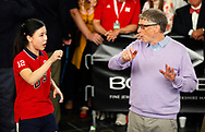 Microsoft founder Bill Gates gets a lesson in table tennis from Ariel Hsing as part of the Berkshire Hathaway annual meeting weekend in Omaha, Nebraska, U.S. May 7, 2017. REUTERS/Rick Wilking