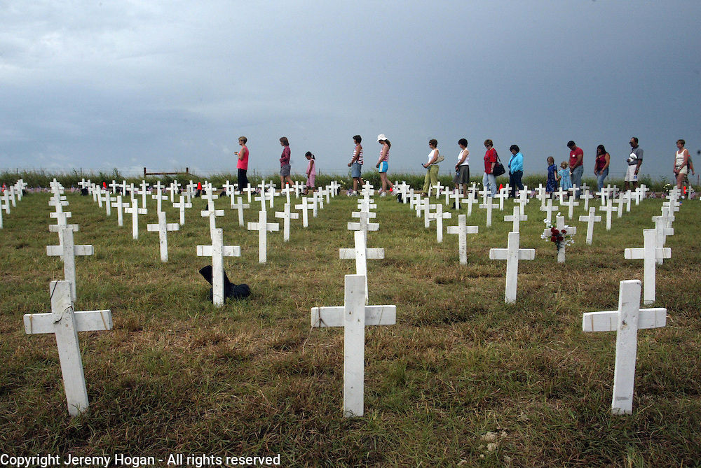 walking meditation among crosses representing fallen U.S. soldiers at Camp Casey II during Cindy Sheehan's vigil