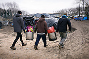 Calais, Januari 2015. Human rights watch reports about the conditions thousands of stranded refugees have to deal with in Calais, on their way to the UK. In camps or 'jungles', several thousand asylum seekers and migrants, people from Syria, Iraq, Eritrea, Ethiopia, Sudan, Pakistan and Afghanistan are living in makeshift camps or in the streets in Calais. Some said that their treatment by police, a lack of housing for asylum seekers, and delays in the French asylum system had deterred them from seeking asylum in France.<br /> <br /> A local organisation helps with the preparation of orthodox new year celebration.