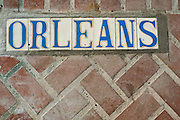 Detail of the Orleans street sign in the French Quarter in New Orleans, Louisiana.