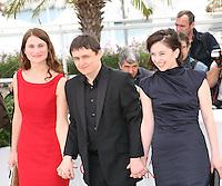 Actress Cristina Flutur, Director Cristian Mungiu and actress Cosmina Stratan at the Dupa Dealuri film photocall at the 65th Cannes Film Festival. Saturday 19th May 2012 in Cannes Film Festival, France.