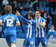 Inigo Calderon, Brighton defender celebrates his second goal during the Sky Bet Championship match between Brighton and Hove Albion and Birmingham City at the American Express Community Stadium, Brighton and Hove, England on 21 February 2015.