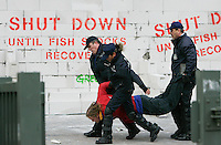 Greenpeace activists are detained by Belgian riot police after building a wall blocking access to the European Council building in Brussels December 17, 2007. The protest took place as EU agriculture and fisheries ministers discussed annual fishing quotas.   REUTERS/Thierry Roge       (BELGIUM)
