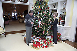 Dec. 24, 1983 - Washington, DC, United States of America - U.S. President Ronald Reagan and First Lady Nancy Reagan decorate the Christmas tree in the private residence of the White House December 24, 1983 in Washington, D.C. (Credit Image: © White House/Planet Pix via ZUMA Wire)