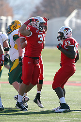 17 November 2012:  Colton Underwood celebrates with Shelby Harris after sacking Brock Jensen during an NCAA Missouri Valley Football Conference football game between the North Dakota State Bison and the Illinois State Redbirds at Hancock Stadium in Normal IL