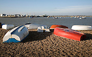 Dinghies on shingle beach by the River Deben at Bawdsey Quay, Suffolk, England