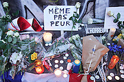 """""""Not even Afraid"""", meme pas peur written in French<br /><br />Place Republique, Parisians pay hommage to those killed and wounded in the Terrorist attacks<br /><br />The Day after the terrorist jihadi attacks. Bullet holes and blood, mourning homage and cleaning up. Aftermath of deadly Paris terrorist attacks. Saturday 14th November 2015<br /> <br /> Eight terrorists dead and some 128 people killed at Stade de France, Bataclan concert Hall, Belle Equipe Restaiurant, Rue Fontaine au Roi, Two hundred people have been injured, 80 of them seriously."""