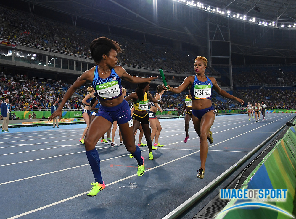 Aug 20, 2016; Rio de Janeiro, Brazil; Phyllis Francis takes the handoff from Natasha Hastings on the third leg of the United States women's 4 x 400m relay that won in 3:19.06 during the 2016 Rio Olympics at Estadio Olimpico Joao Havelange. <br /> <br /> *