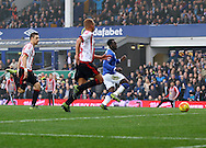 Romelu Lukaku of Everton slides the ball home and scores his teams 4th goal. Barclays Premier League match, Everton v Sunderland at Goodison Park in Liverpool on Sunday 1st November 2015.<br /> pic by Chris Stading, Andrew Orchard sports photography.