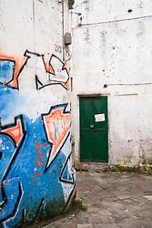 Graffiti ad un angolo di una via del centro storico di Racale (LE)