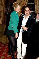 LADY ELOISE ANSON and LUIS MIGUEL HOWARD at a private view of jewellery designed and made by Luis Miguel Howard held at 30 Pavillion Road, London on 27th October 2004.<br />