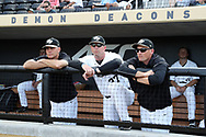WINSTON-SALEM, NC - JUNE 02: Wake Forest head coach Tom Walter (left) with assistants Bill Cilento (37) and Eric Niesen. The Wake Forest Demon Deacons hosted the University of Maryland Baltimore County Retrievers on June 2, 2017, at David F. Couch Ballpark in Winston-Salem, NC in NCAA Division I College Baseball Tournament Winston-Salem Regional Game 2. Wake Forest won the game 11-3.