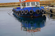 Tugboat at the Venetian era harbour, Chania, Crete, Greece