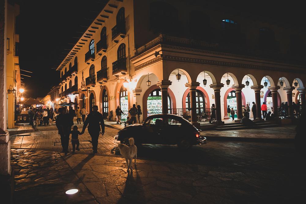 Night in San Cristóbal de las Casas, Mexico - November 19, 2014: Pedestrians walk in the city center at night in the beautiful colonial town of San Cristóbal de las Casas in the Mexican state of Chiapas.