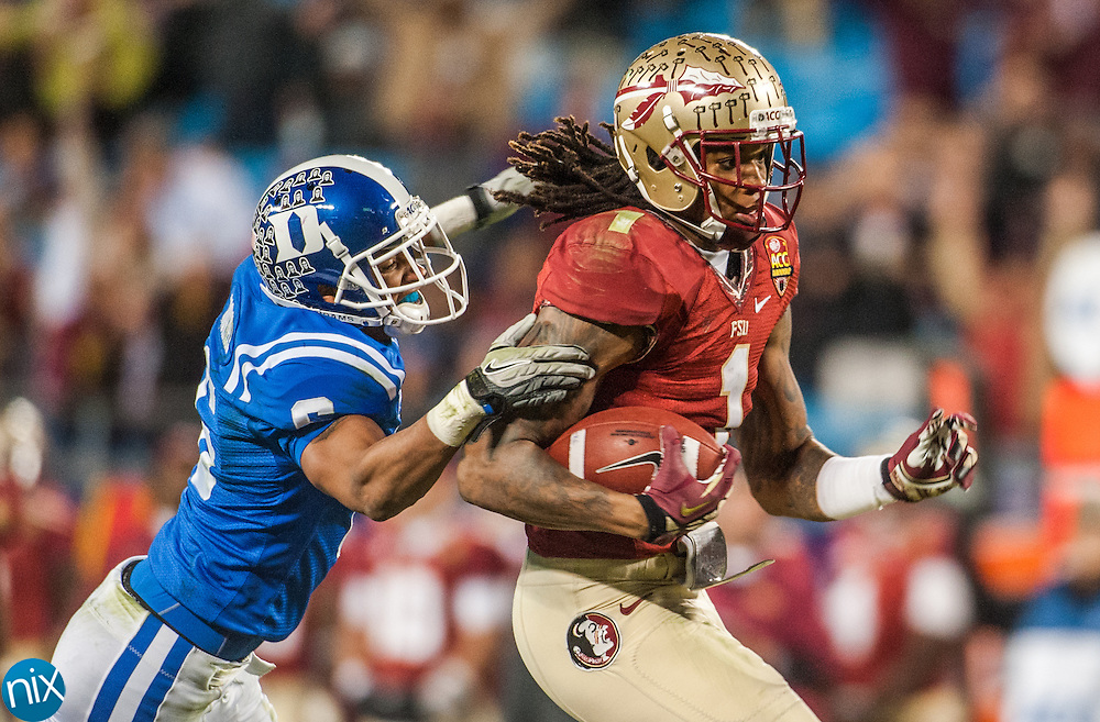 Florida State's Kelvin Benjamin gets past Duke's Ross Cockrell on his way to the end zone during the ACC Championship game at Bank of America Stadium in Charlotte Saturday night. Florida State won the game 45-7.