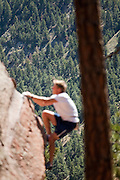 "Will Levandowski sets a new record for most vertical feet climbed in 24 hours on a boulder at Fagstaff in Boulder, Colorado. Levandowski climbed 2883 laps on a 10' 1.25"" rock, a total of 29130.3 feet, several feed higher than Mount Everest (29,029 ft). The minimum requirement from Guinness World Records was 25,000."