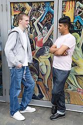 Two teenaged boys hanging around town,
