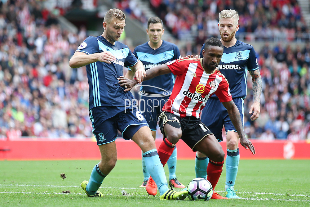 Middlesbrough defender Ben Gibson (6)  gets a toe to the ball to stop Sunderland forward Jermain Defoe (18)  during the Premier League match between Sunderland and Middlesbrough at the Stadium Of Light, Sunderland, England on 21 August 2016. Photo by Simon Davies.