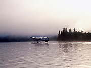 Lee Fink taxiing Piper Tri-Pacer as morning fog rolls over Hardenburg Bay, Lake Clark National Park and Preserve, Port Alsworth, Alaska.