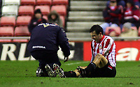 Photo. Andrew Unwin.<br /> Sunderland v Rotherham, Coca-Cola Championship, Stadium of Light, Sunderland 22/02/2005.<br /> Sunderland's Julio Arca (R) receives treatment on an injury that he tried to play through but later had to leave the field to be substituted.