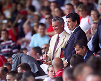 Photo. Jed Wee<br /> Liverpool v Valencia, Pre-season Friendly, Anfield, Liverpool. 09/08/2003.<br /> Chelsea manager Claudio Ranieri (L) signs autographs but could just as easily be looking to sign any one of the players involved in today's game.