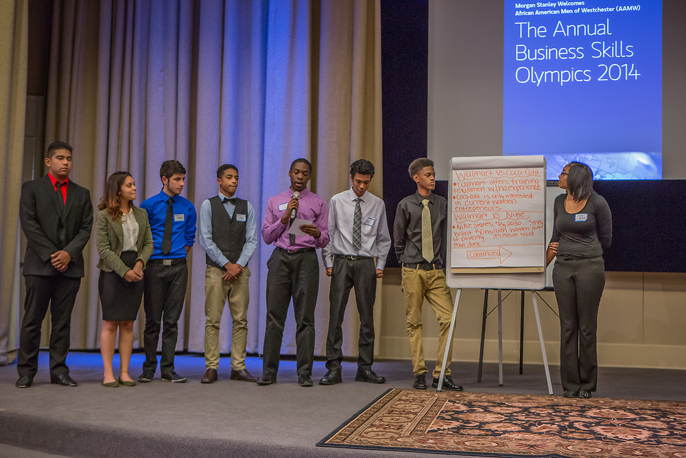 Purchase, NY – 31 October 2014. The team from Saunders Trades and Technical High School presenting. (Left to right: Andrew Cardenas,  Gabriella Perez, Leonardo Gabbato, Charlie Hernandez, Raymond Uduba, Paul Huitz,  Jay'quan Carson, Chyna Artist.) The Business Skills Olympics was founded by the African American Men of Westchester, is sponsored and facilitated by Morgan Stanley, and is open to high school teams in Westchester County.