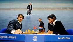 17-01-2011 SCHAKEN: TATA STEEL CHESS TOURNAMENT: WIJK AAN ZEE <br /> Anish Giri heeft in de derde ronde van het Tata Steel Schaaktoernooi in Wijk aan Zee voor een grote verrassing gezorgd. De 16-jarige schaker uit Rijswijk versloeg maandag in recordtempo de Noor Magnus Carlsen NOO<br /> ©2010-WWW.FOTOHOOGENDOORN.NL