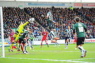 Plymouth Argyle goalkeeper Luke McCormick punches a crossed ball out of danger during the Sky Bet League 2 match between Plymouth Argyle and York City at Home Park, Plymouth, England on 28 March 2016. Photo by Graham Hunt.