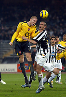 Photo: Chris Ratcliffe.<br /> Juventus v Arsenal. UEFA Champions League. Quarter-Finals. 05/04/2006. <br /> Philippe Senderos of Arsenal gets up above Giorgio Chiellini of Juventus to get a header in on goal