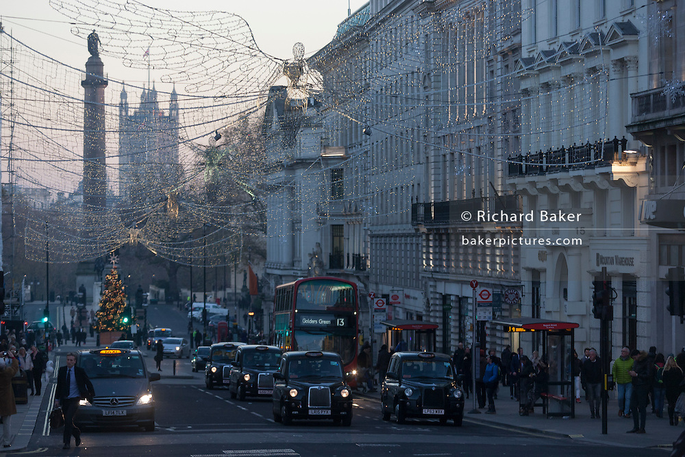 Taxies and cars drive up Lower Regent Street, beneath Christmas lights on 1st December 2016, in Piccadilly Circus, London England. (Photo by Richard Baker / In Pictures via Getty Images)