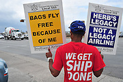 Southwest Airlines employees protest proposals to outsource some jobs, among other complaints, outside of Dallas Love Field on Thursday, March 28, 2013. (Cooper Neill/The Dallas Morning News)