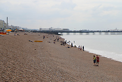 © Licensed to London News Pictures. 14/06/2014. Brighton, UK. Brighton beach on Saturday morning awaiting the flood of sun seekers and holiday makers. The weekend is expected to be the hottest of the year so far with temperatures reaching close to 30C down the south coast. Photo credit : Hugo Michiels/LNP
