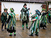 Makara Morris Men dancing a stick dance at an orchard-visiting wassail in Kilham village, Yorkshire Wolds, UK on 21st January 2017. Wassail is a traditional Pagan winter celebration in cider-producing regions of England, reciting incantations and singing to the trees to promote a good harvest for the coming year. Pieces of toast soaked in cider are hung in the branches to attract robins to the tree as these are said to be the good spirits of the orchard. To ward off evil spirits, villagers scare them away by banging pots and pans and making as much noise as possible