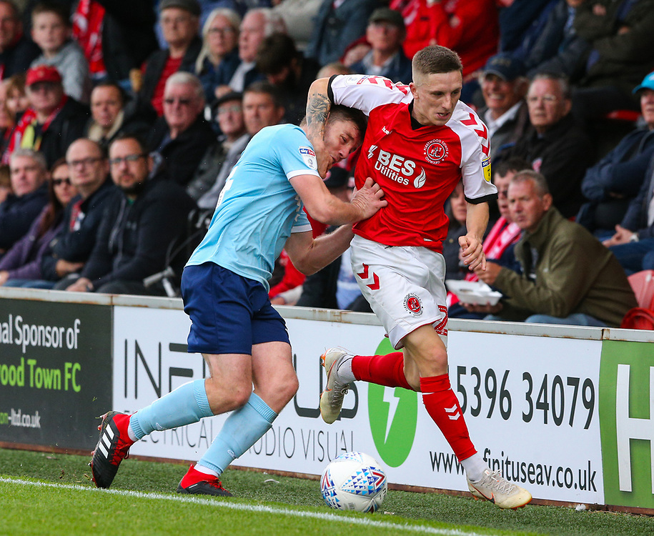 Fleetwood Town's Ashley Hunter battles with Accrington Stanley's Sam Finley<br /> <br /> Photographer Alex Dodd/CameraSport<br /> <br /> The EFL Sky Bet League One - Fleetwood Town v Accrington Stanley - Saturday 15th September 2018  - Highbury Stadium - Fleetwood<br /> <br /> World Copyright © 2018 CameraSport. All rights reserved. 43 Linden Ave. Countesthorpe. Leicester. England. LE8 5PG - Tel: +44 (0) 116 277 4147 - admin@camerasport.com - www.camerasport.com