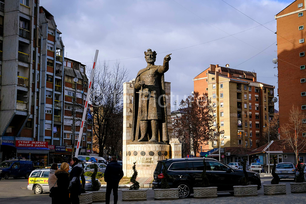 A statue of Prince Lazar of Serbia on the Serbian side north side of the Mitrovica bridge, over the river Ibar which separates the Serbian and Albanian districts of Mitrovica, Kosovo on the 12th of December 2018. Prince Lazar Hrebeljanovic was a Serbian ruler who died in 1389 that created the most powerful state in the Sebian Empire.